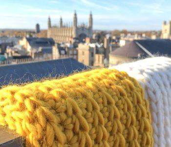 crochet infinity scarf with cambridge uk in back drop