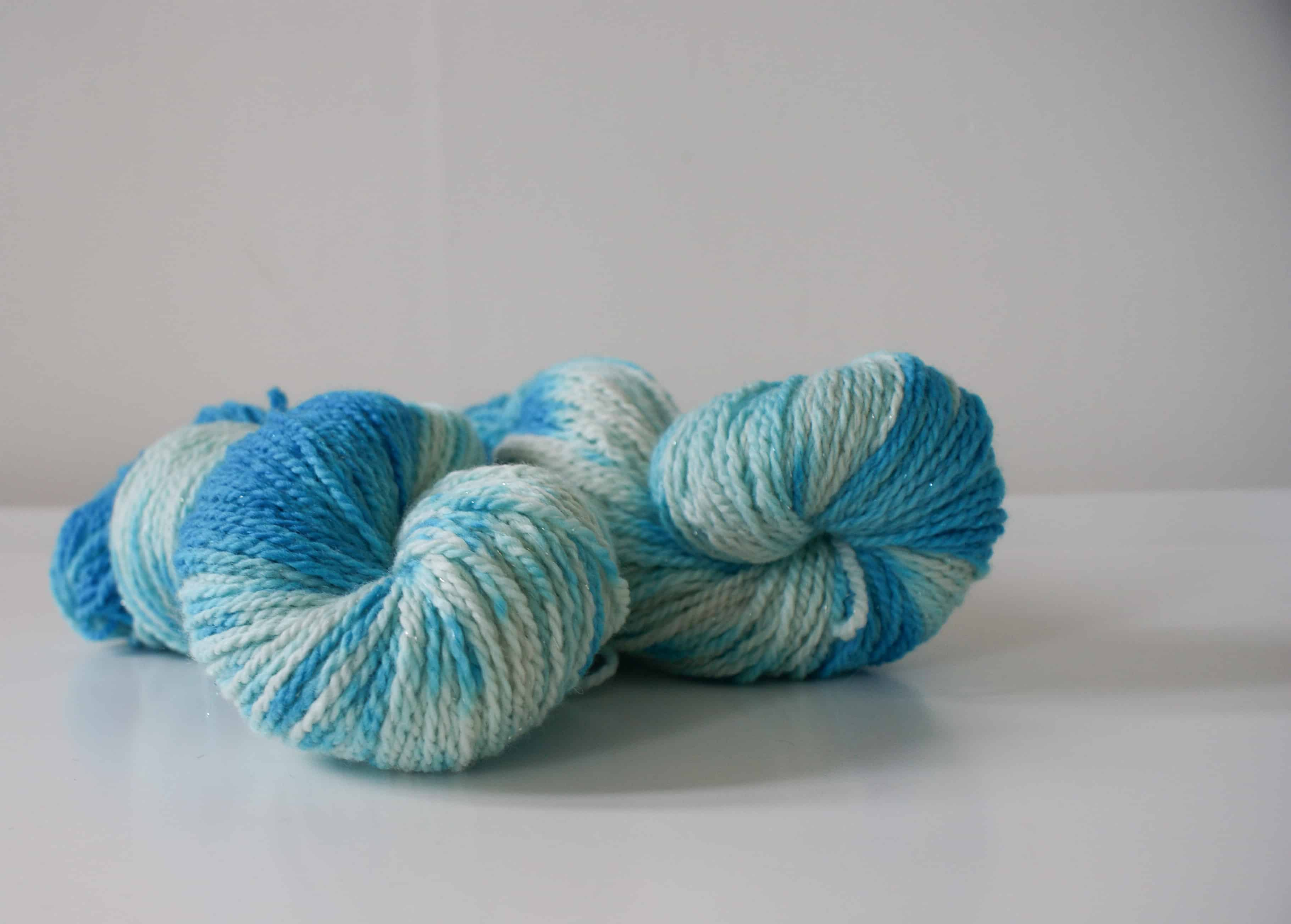 two hanks of blue and white hand dyed yarn